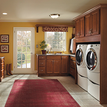 Functional use cabinets in a laundry room area