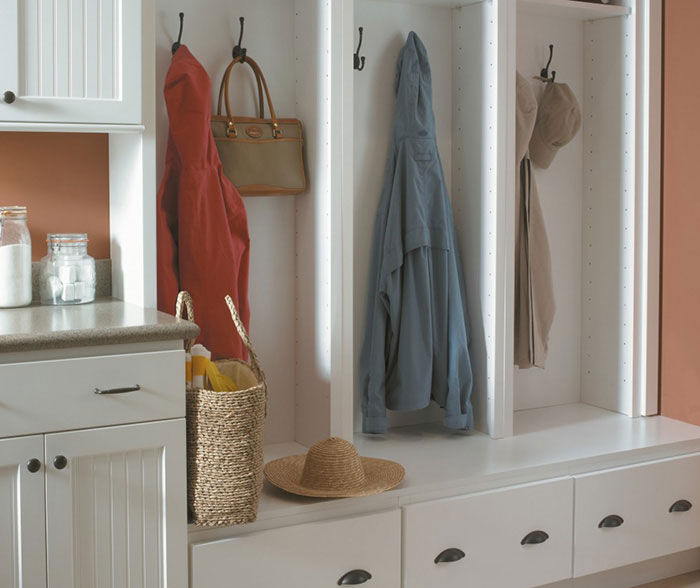 White beadboard cabinets in a laundry room by Homecrest Cabinetry