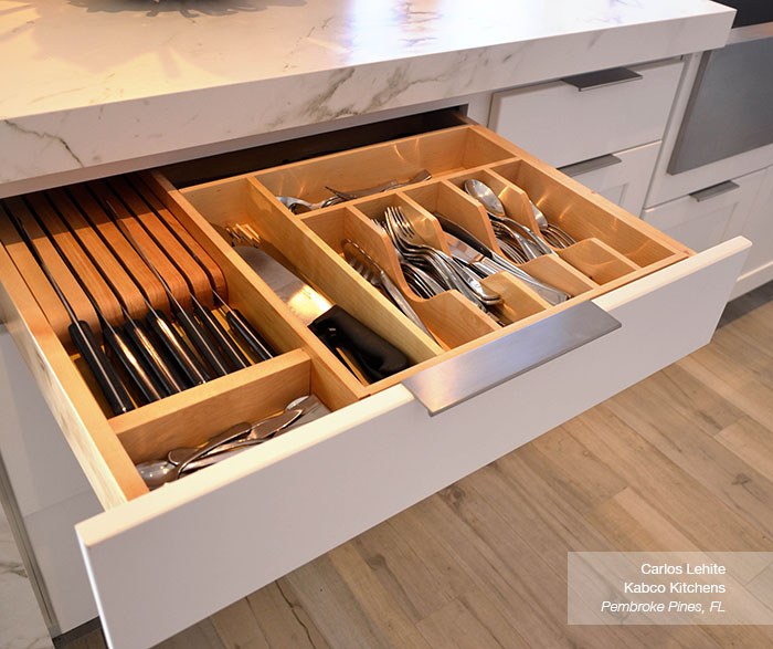 Close up of cabinet drawer organization in white Dover cabinets