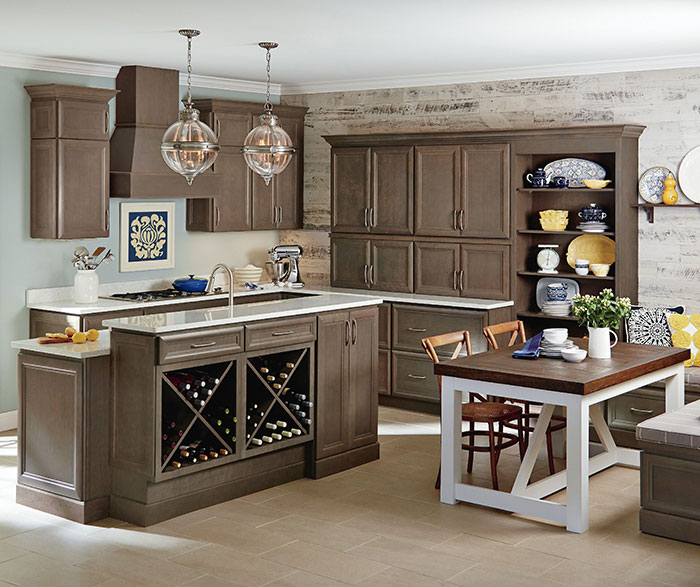 Gray cabinets in a casual kitchen by Homecrest Cabinetry