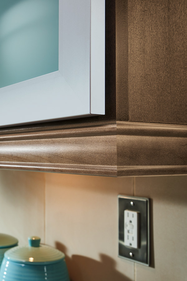 Close-up of light rail moulding on Maple kitchen cabinets
