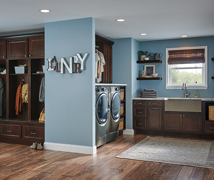 Jordan entry and laundry cabinets in a dark Maple Porter finish