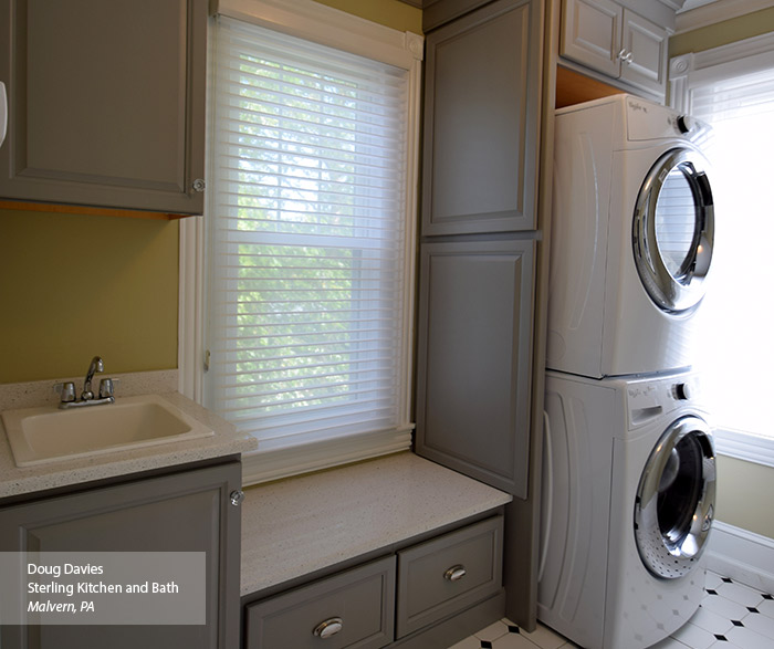 Gray laundry room cabinets in the Ogilby door style